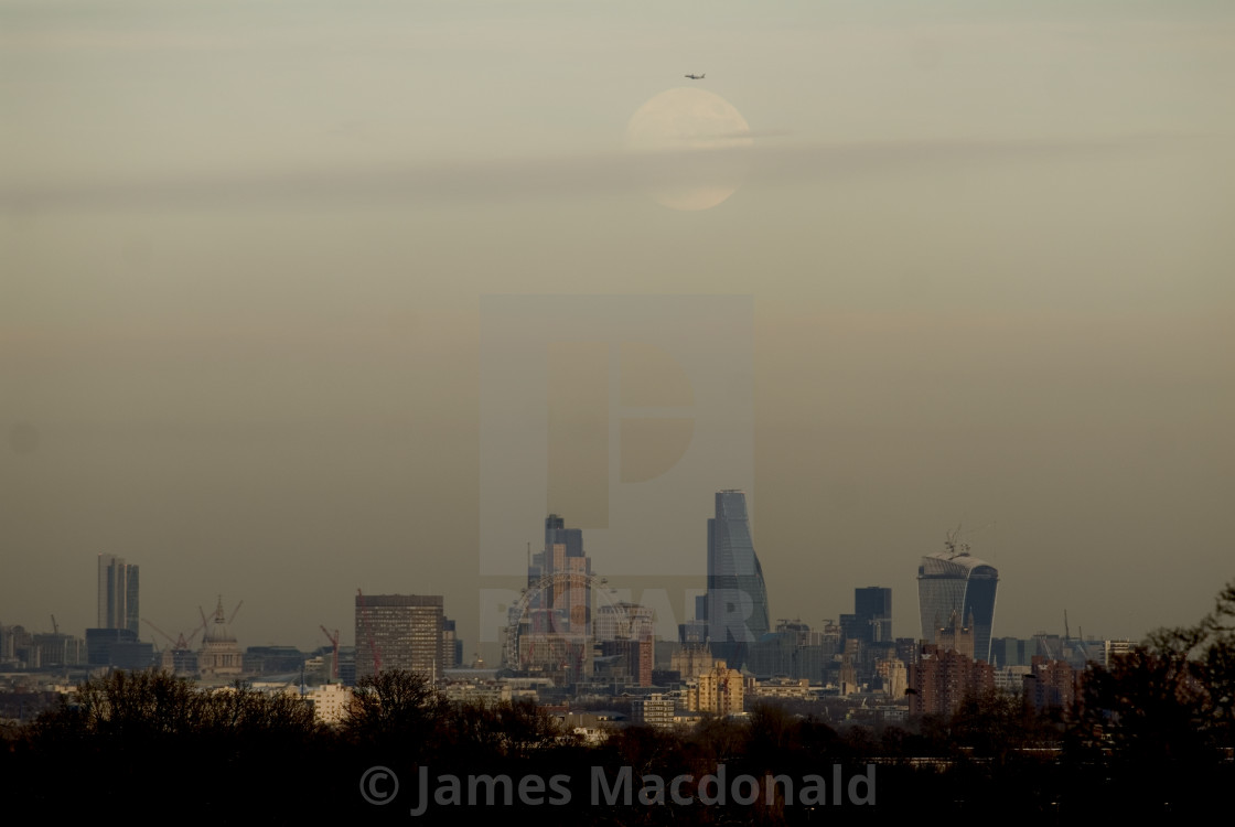 """The moon rises above central London"" stock image"