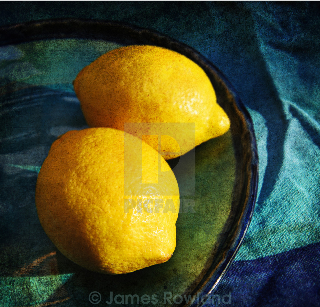 """Lemons on a blue plate"" stock image"