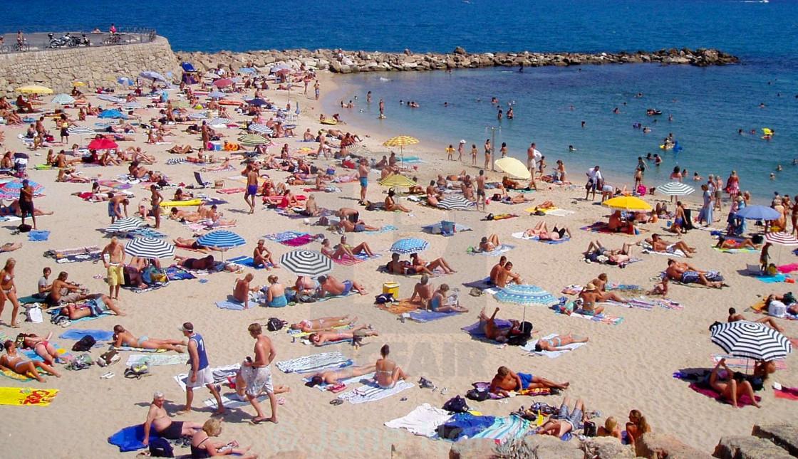 """Beach bathers"" stock image"