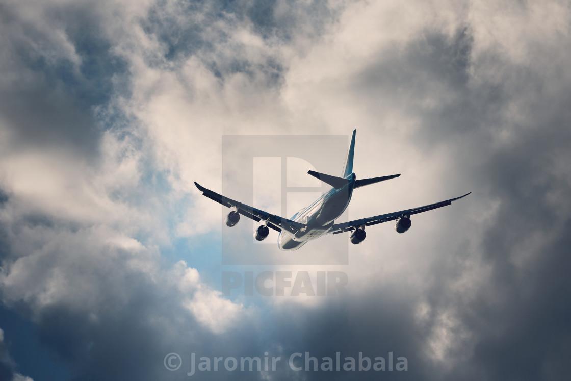 """Flight in bad weather"" stock image"