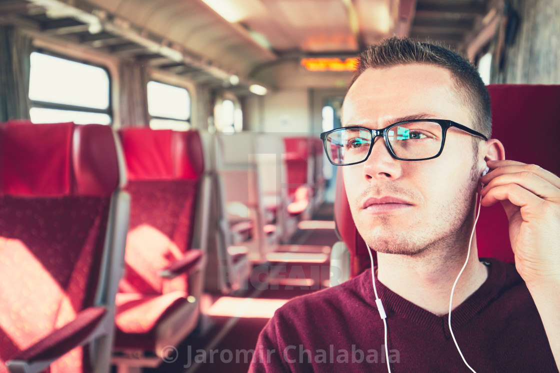 """Young man traveling by train"" stock image"