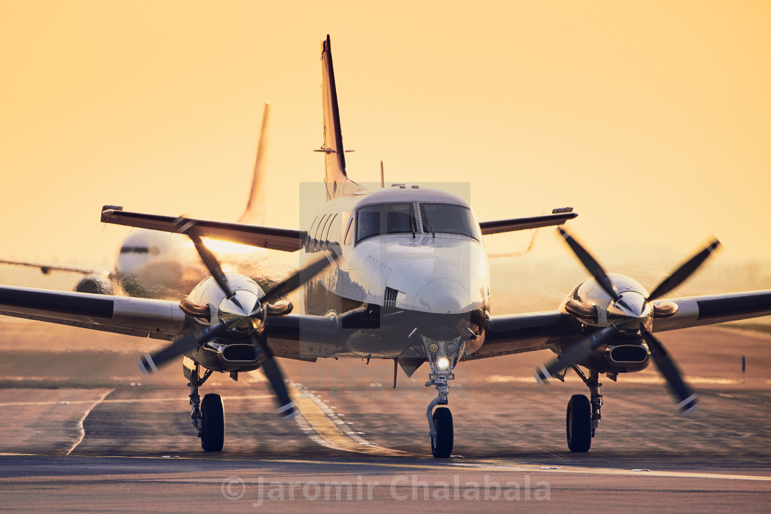 """""""Traffic at airport during sunset"""" stock image"""