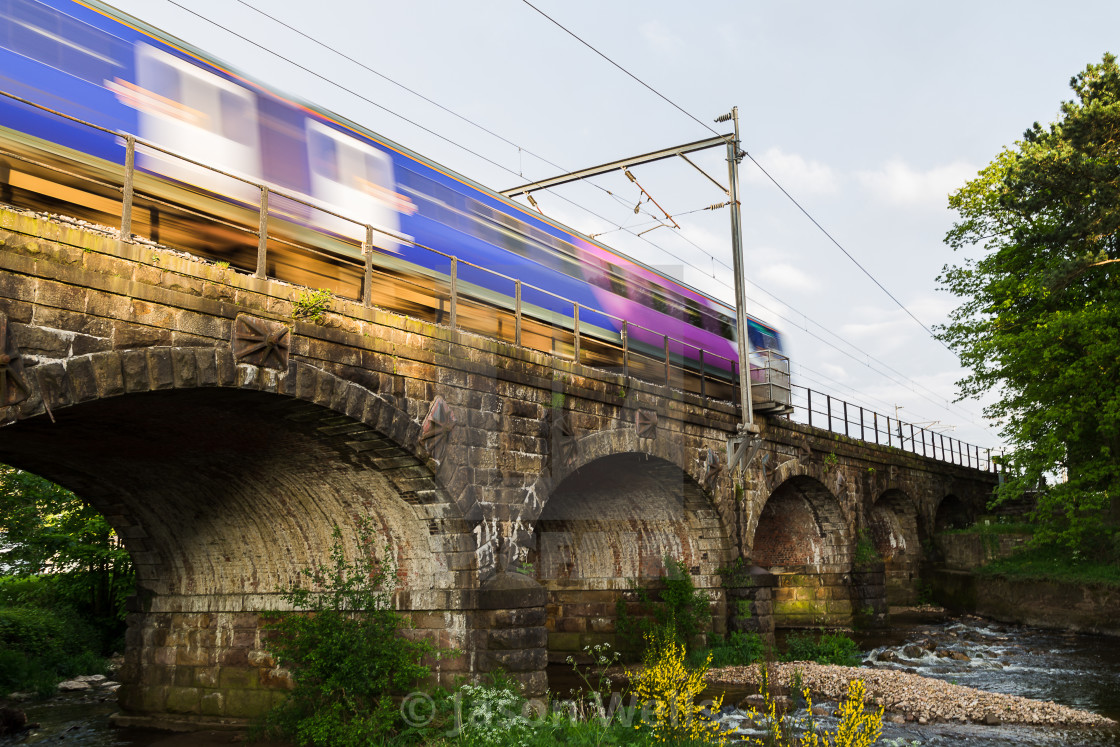 """Transpennine Express train over the arches"" stock image"