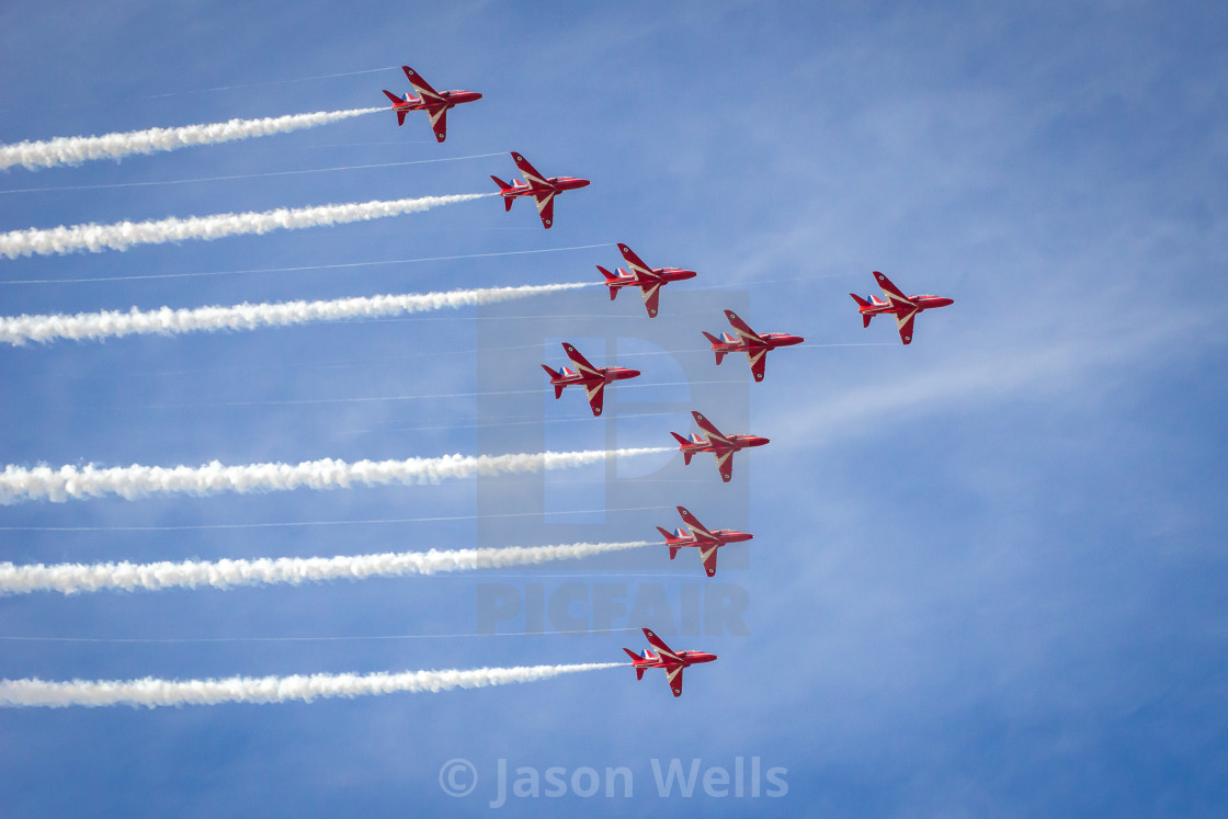 """""""Red Arrows in """"Big Nine"""" formation - at the Southport airshow."""" stock image"""