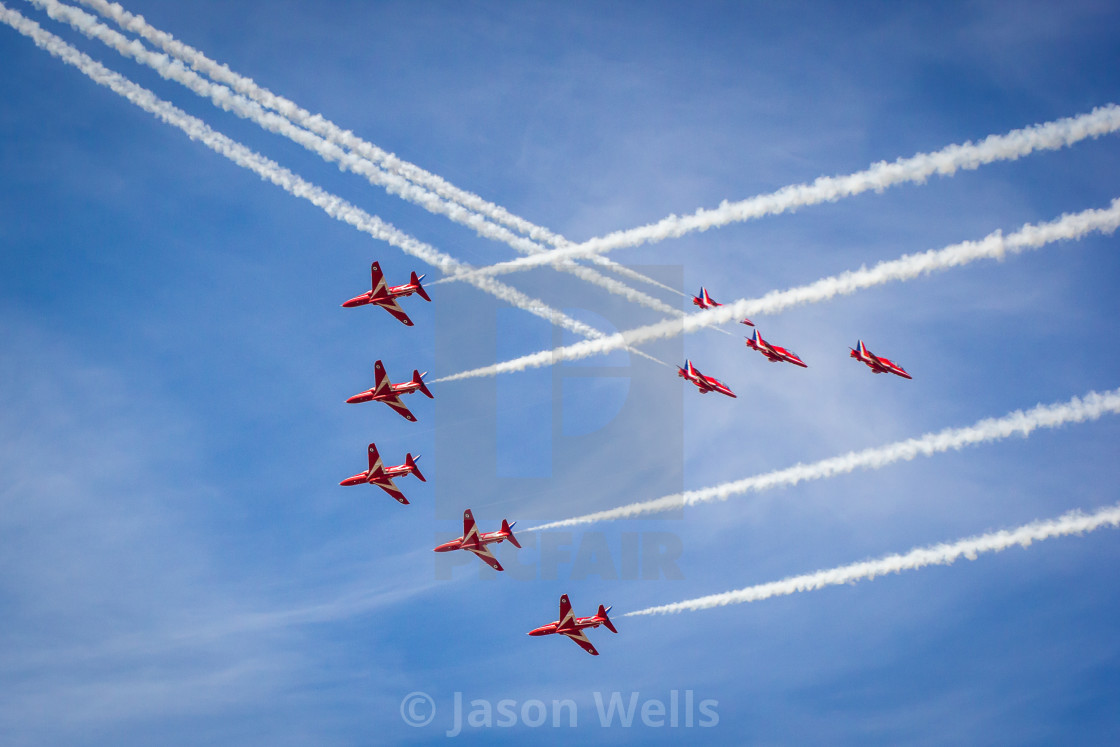 """Red Arrows cross in ""Enid"" & ""Small Swan"" formations - at the Southport airshow."" stock image"