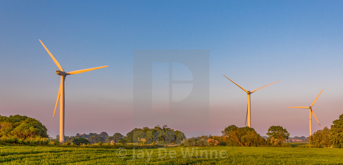 """Three Wind Turbines at Sunset"" stock image"