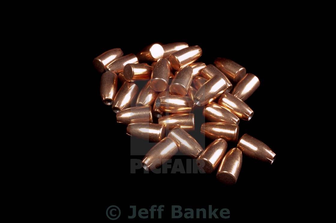 """9mm bullets on black"" stock image"