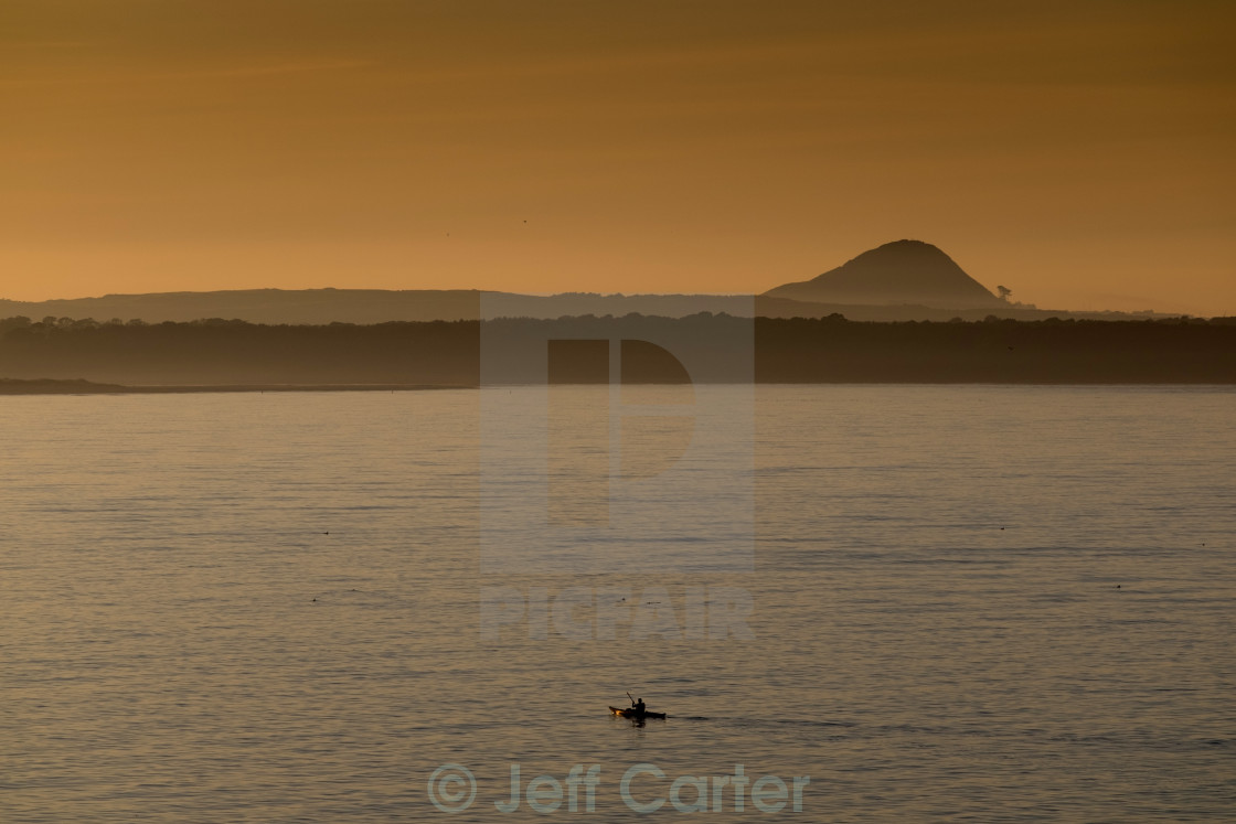 """Kayaker in Belhaven Bay"" stock image"
