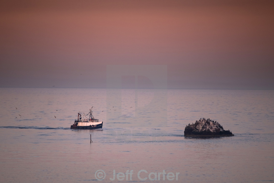 """Fishing Boat Heads Home"" stock image"