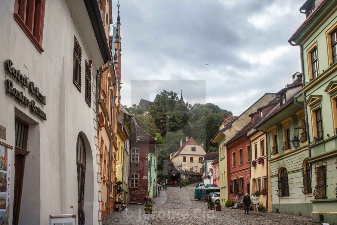 """SIGHISOARA, ROMANIA - SEPTEMBER 22, 2017: Main street of the Sighisoara..."" stock image"