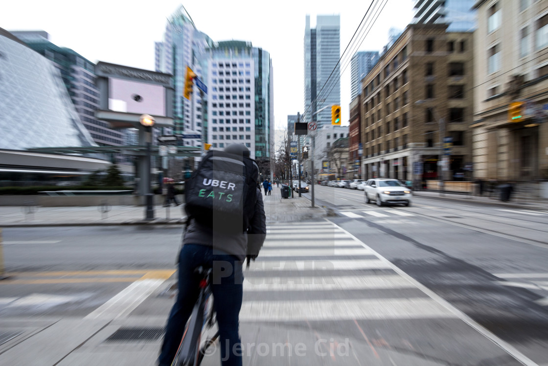 TORONTO, CANADA - DECEMBER 31, 2016: Uber Eats delivery man