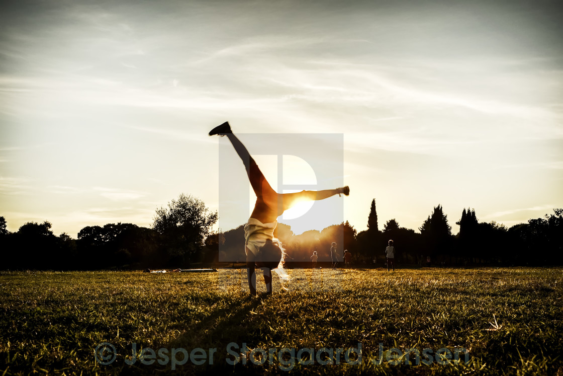 """Fun in the sunset"" stock image"