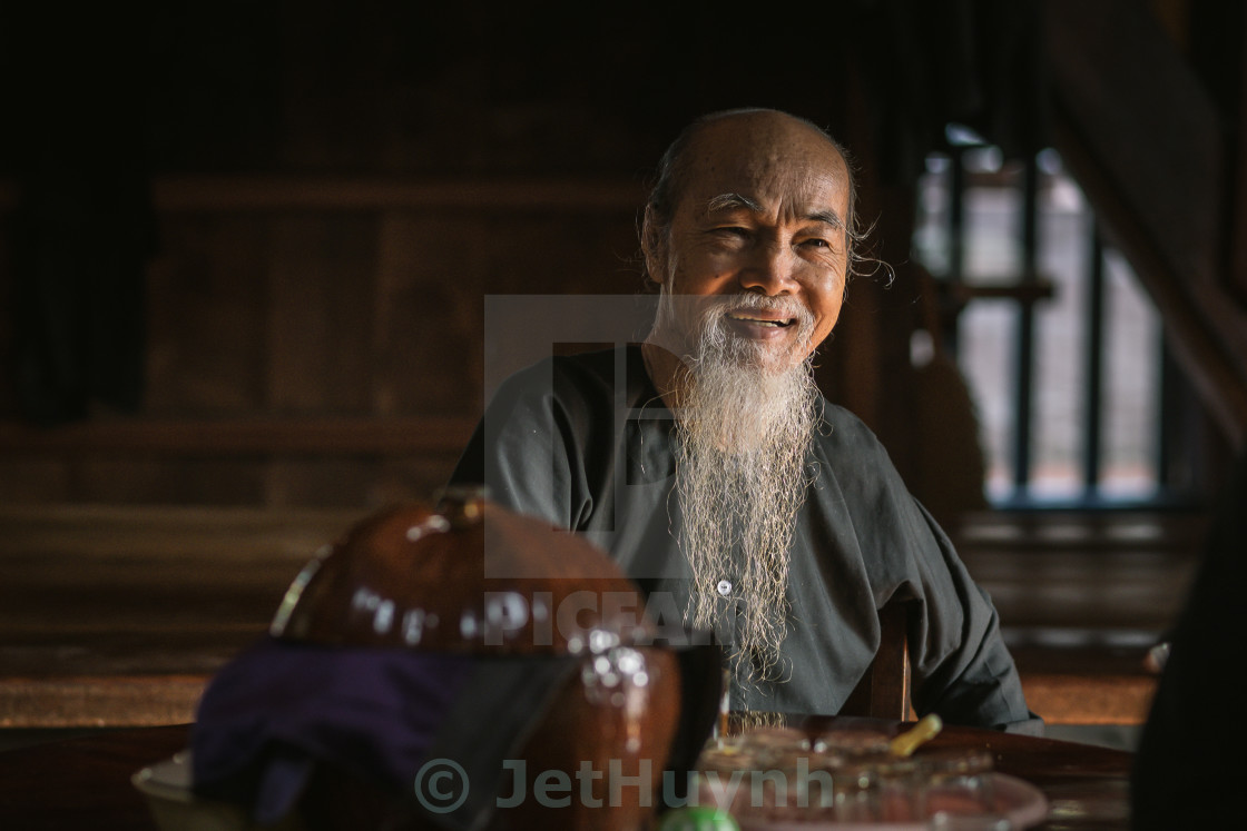 """a calligraphy men with smile at Long Son"" stock image"