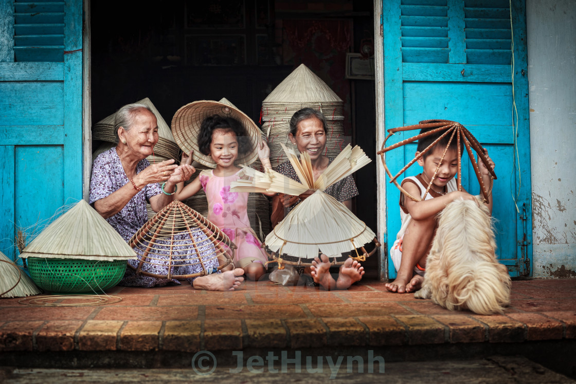 """conical hat maker family at Vietnam"" stock image"