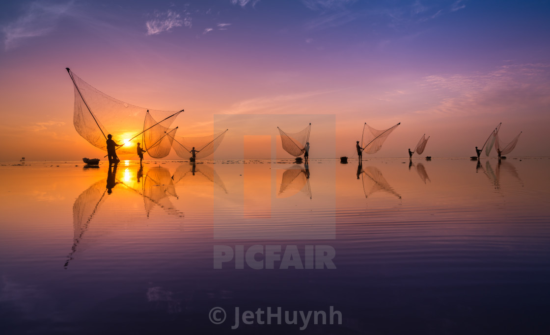 """Clam harvesting - fisherman at sunrise"" stock image"