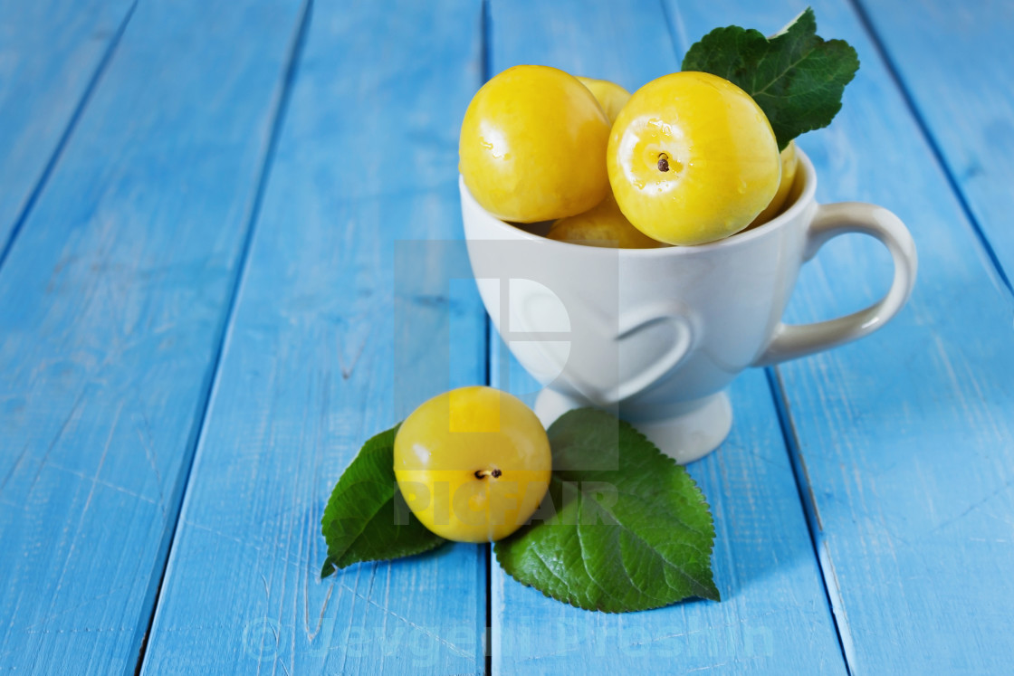 """Ripe yellow plums"" stock image"