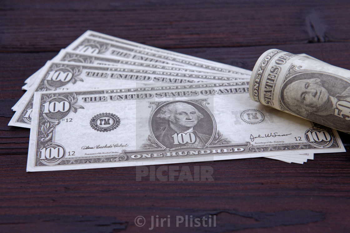 """Dollar banknotes on a wooden table"" stock image"