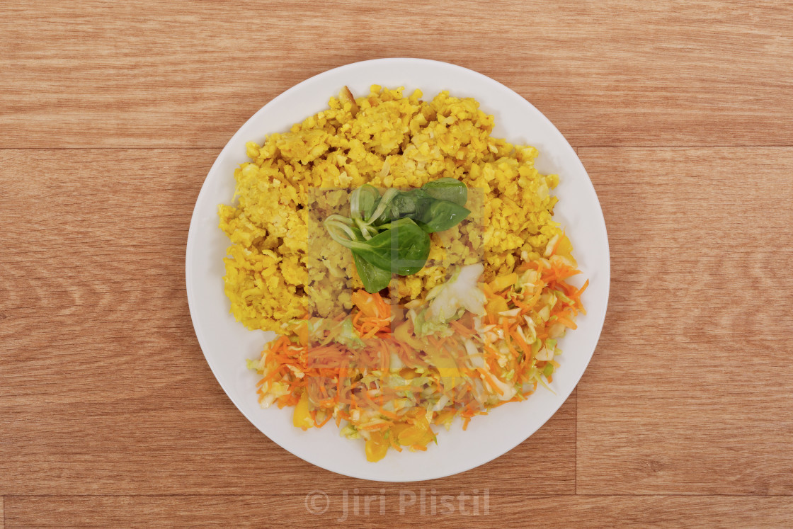 """Baked Bulgar with cauliflower and vegetable salad on a table"" stock image"