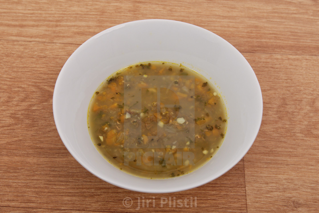 """Lentil soup with carrot on a table"" stock image"