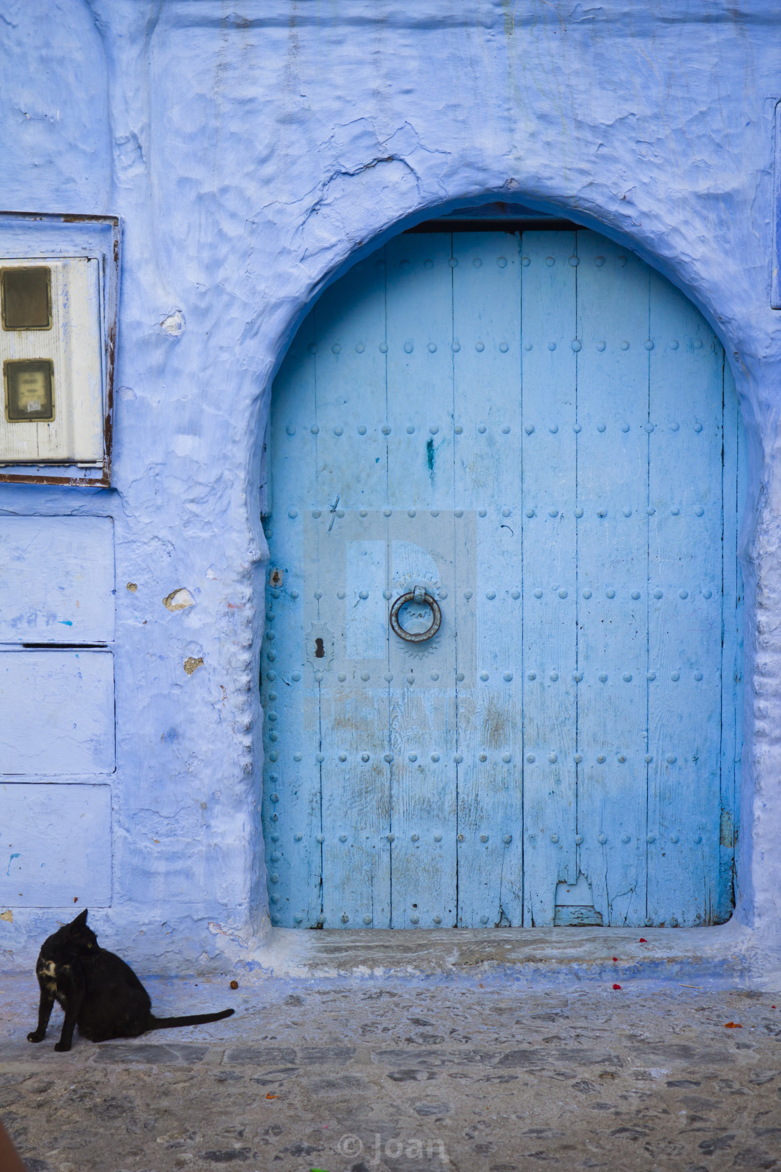 """Blue door in Chefchaouen"" stock image"