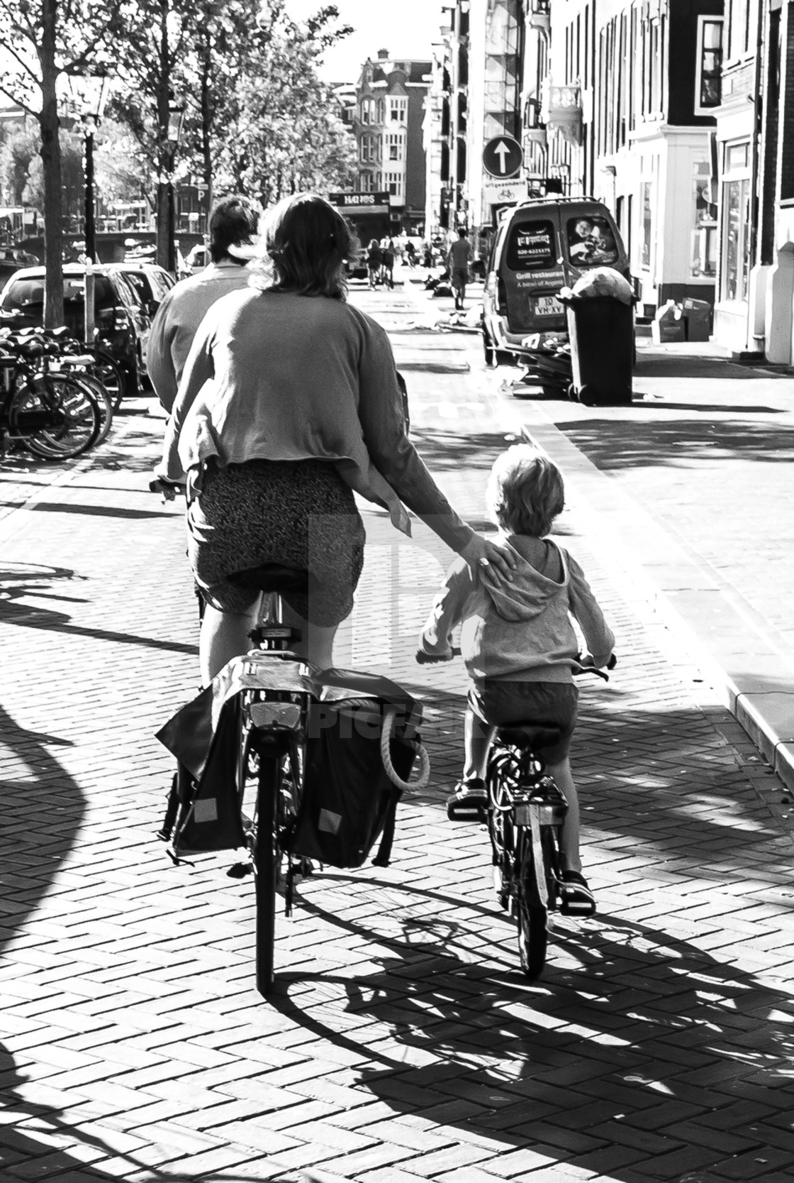 """""""Mother and son cycling"""" stock image"""