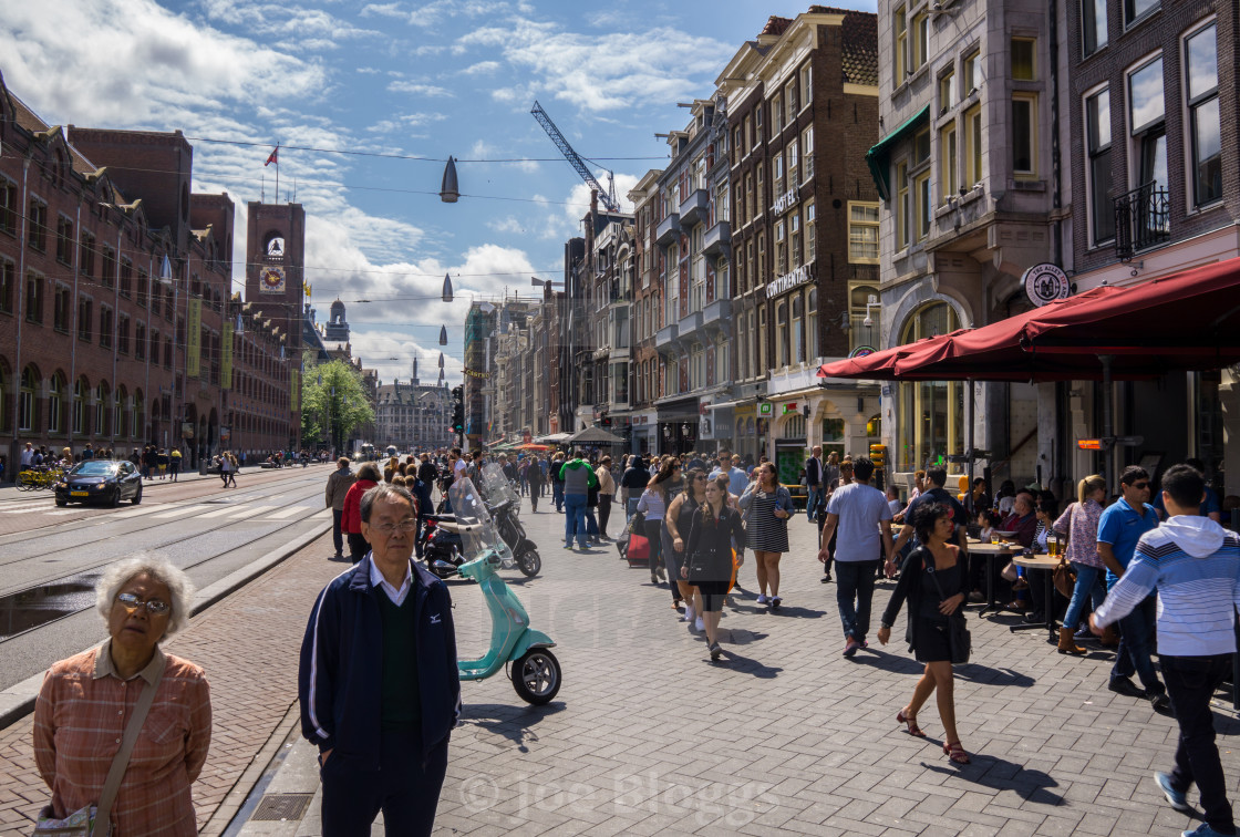 """Amsterdam tourists on the Damrak"" stock image"