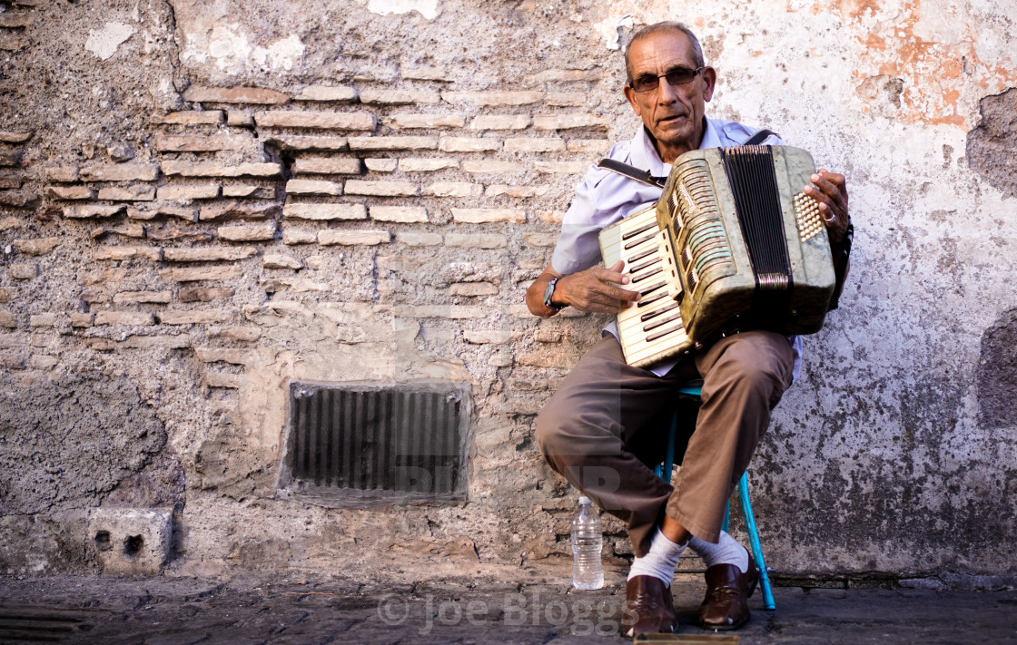 """Italian accordion busker in Naples"" stock image"