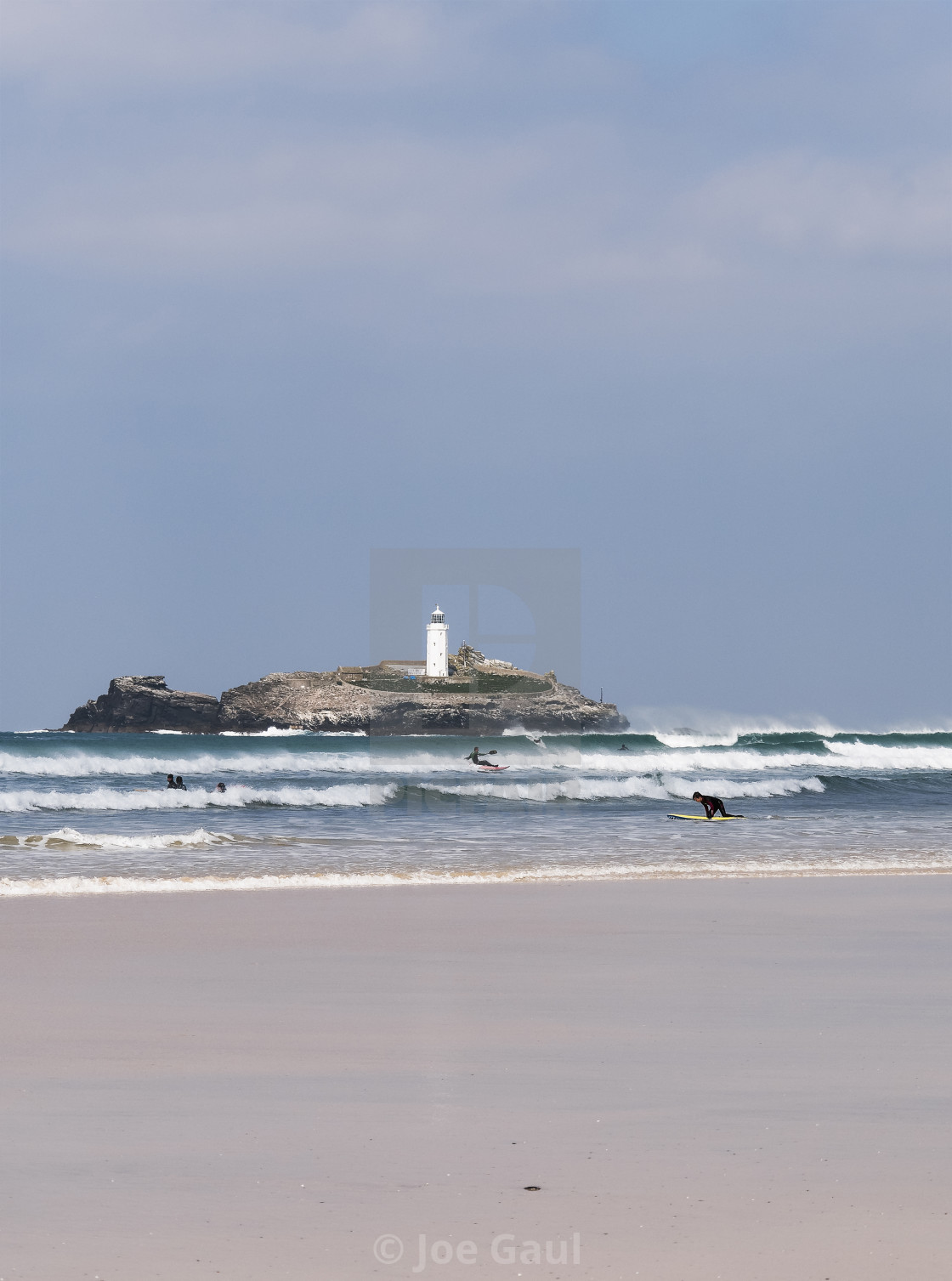 """""""Watersports at Cornwall with Godrevy loghthouse in background an"""" stock image"""