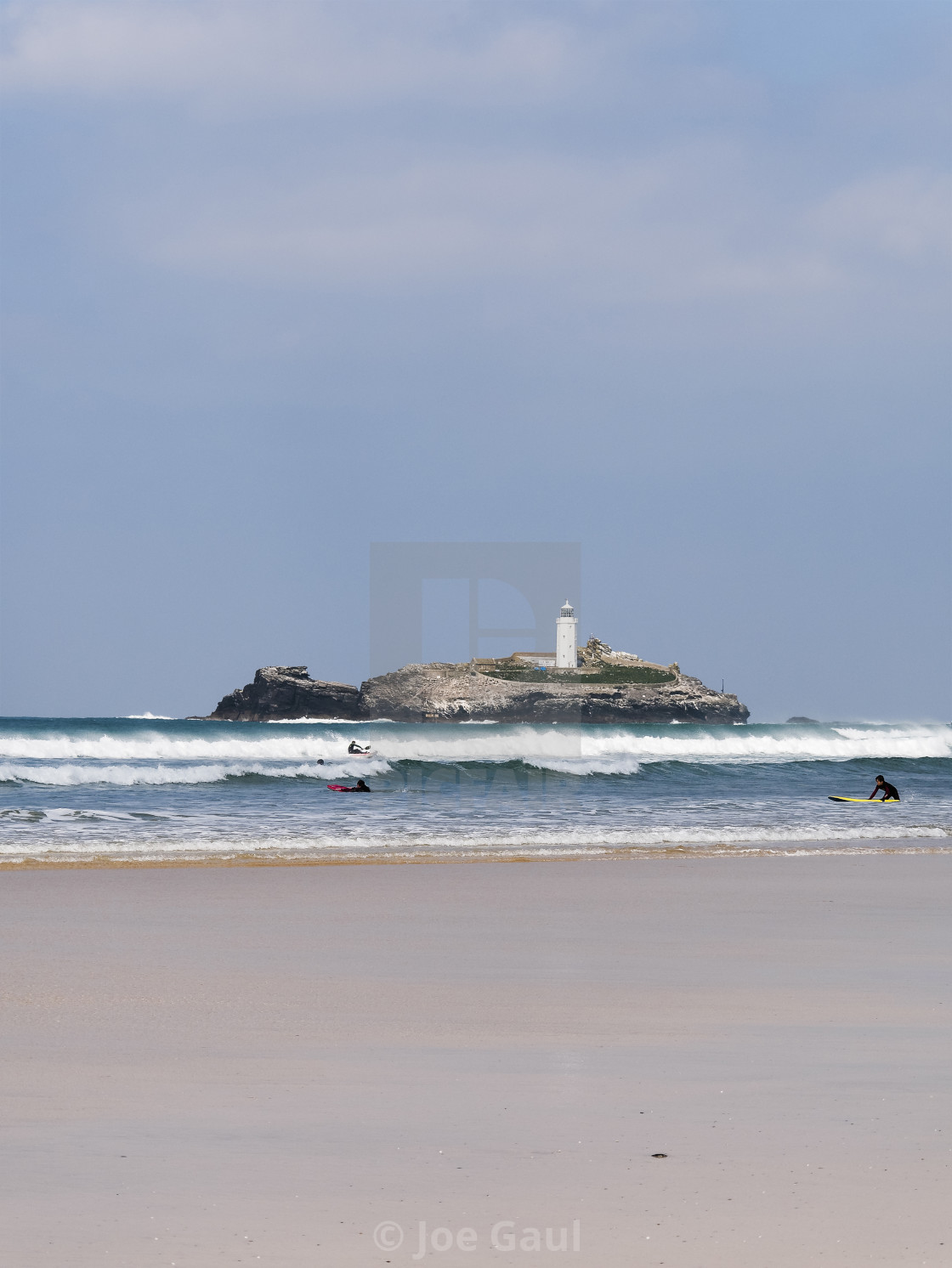 """Watersports at Cornwall with Godrevy loghthouse in background an"" stock image"