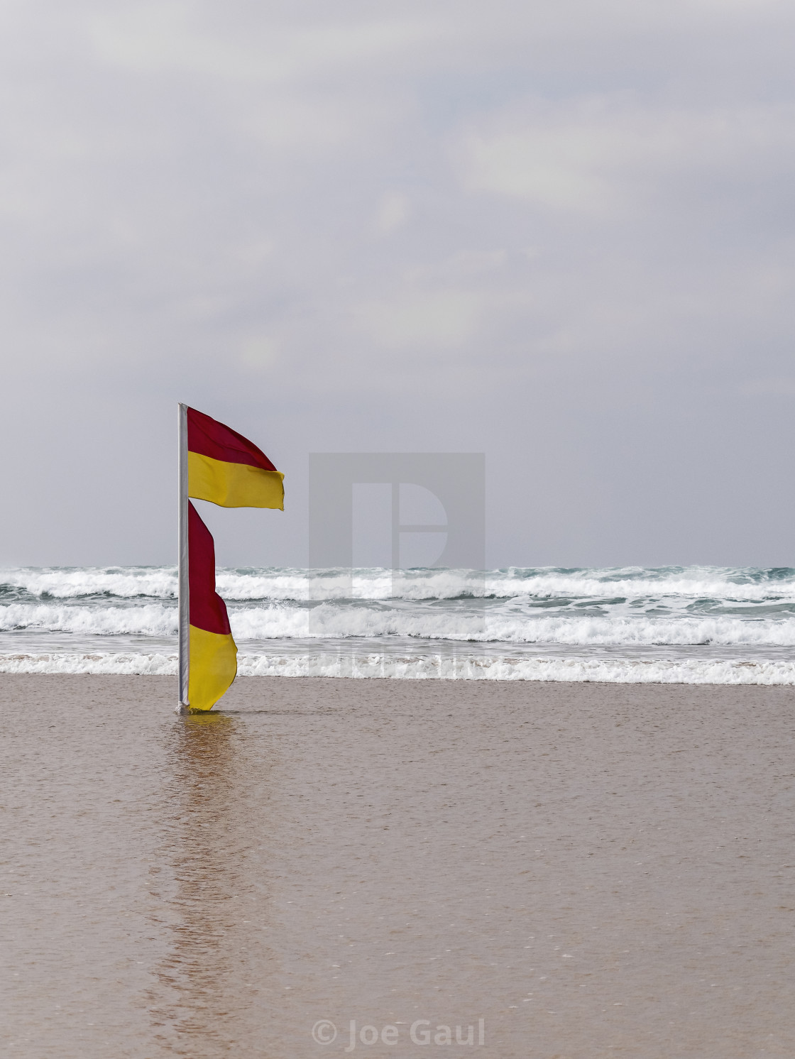 """Warning flag on UK beach at Cornwall"" stock image"