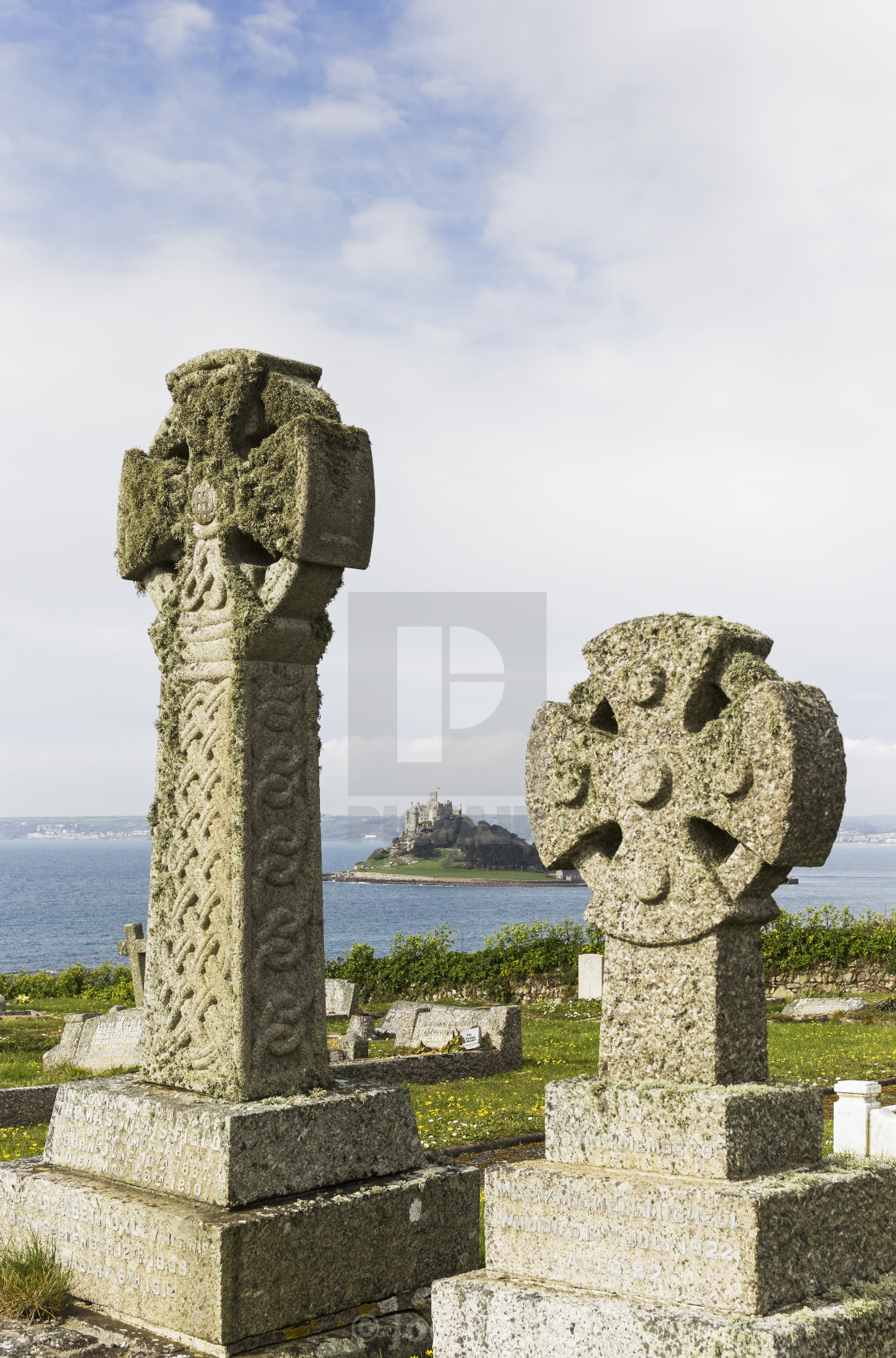 """Celtic crosses in Cornwall cemetery with St Michael's Mount"" stock image"