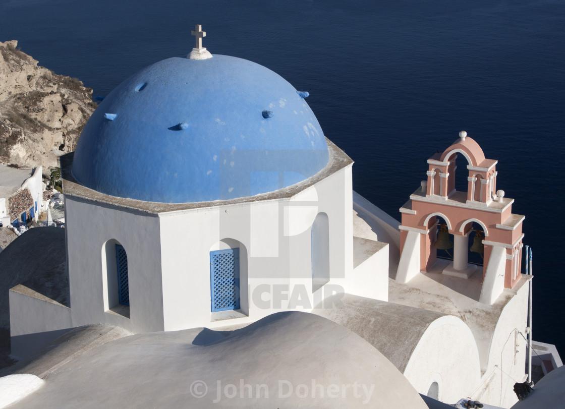 """Clifftop Greek Orthodox Church and Belltower on Santorini"" stock image"