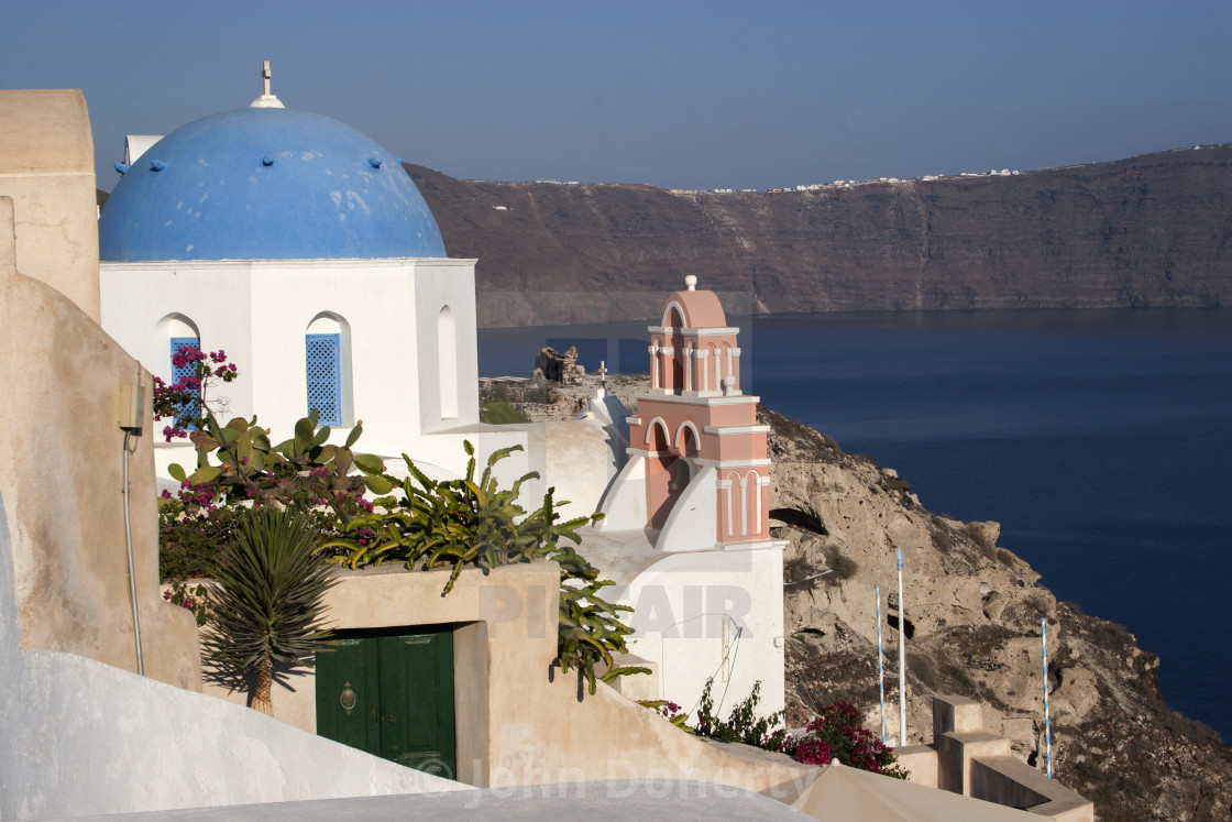 """Greek Orthodox Church Overlooking the Caldera on Santorini"" stock image"