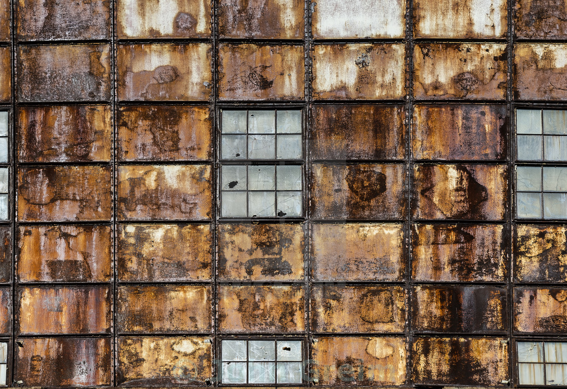 """Abandoned factory facade abstract"" stock image"