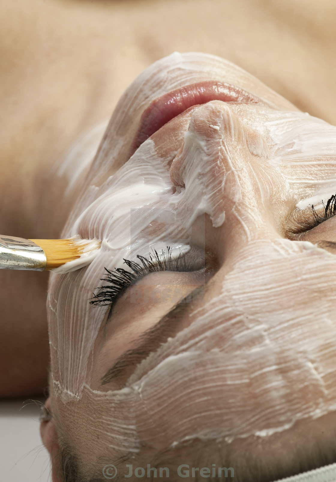 """Woman getting facial treatment at a spa"" stock image"