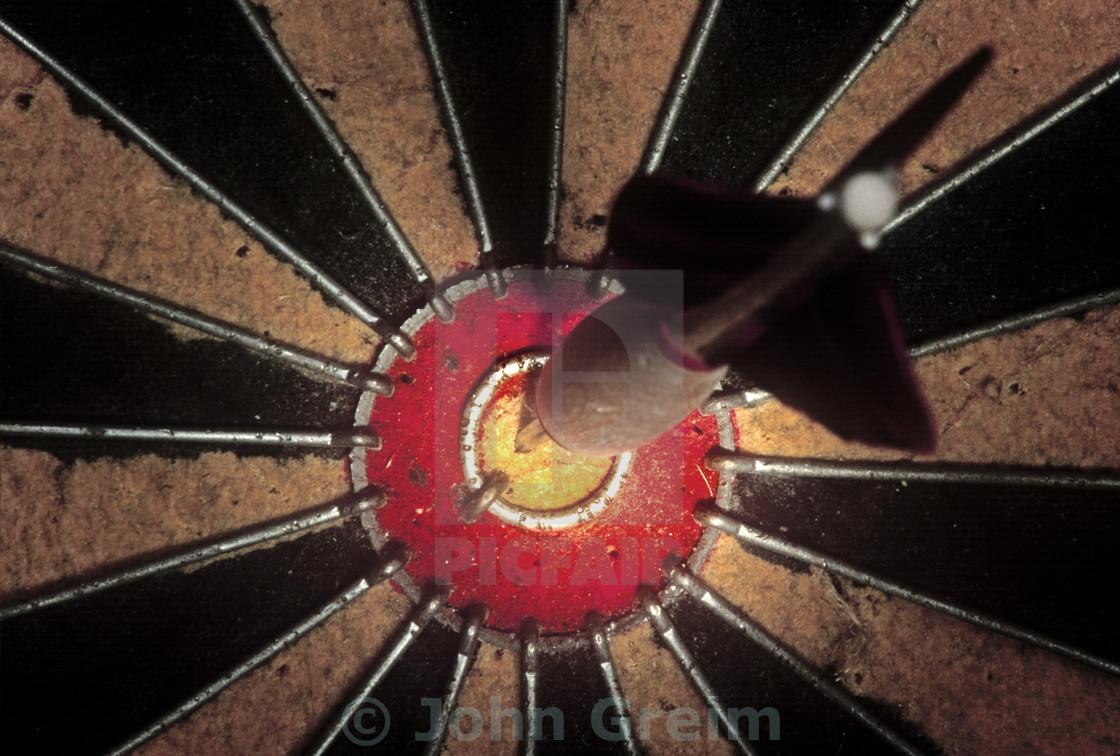 """Dart in bulls eye."" stock image"