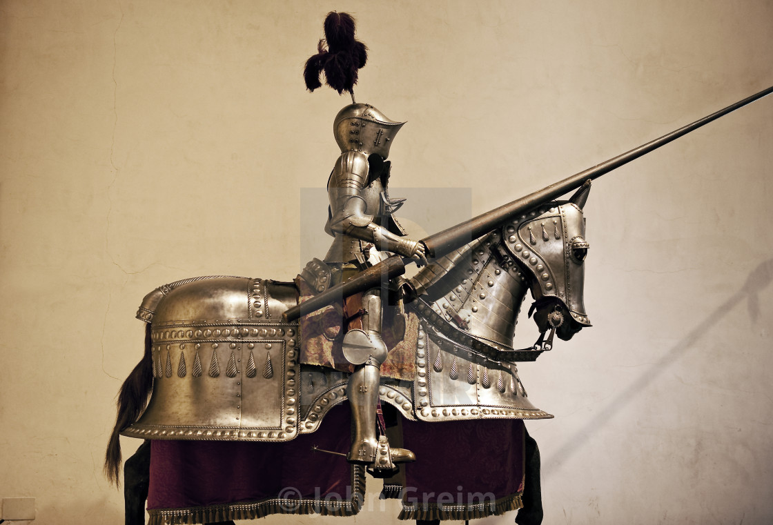 """Knight and horse in suit of armor"" stock image"