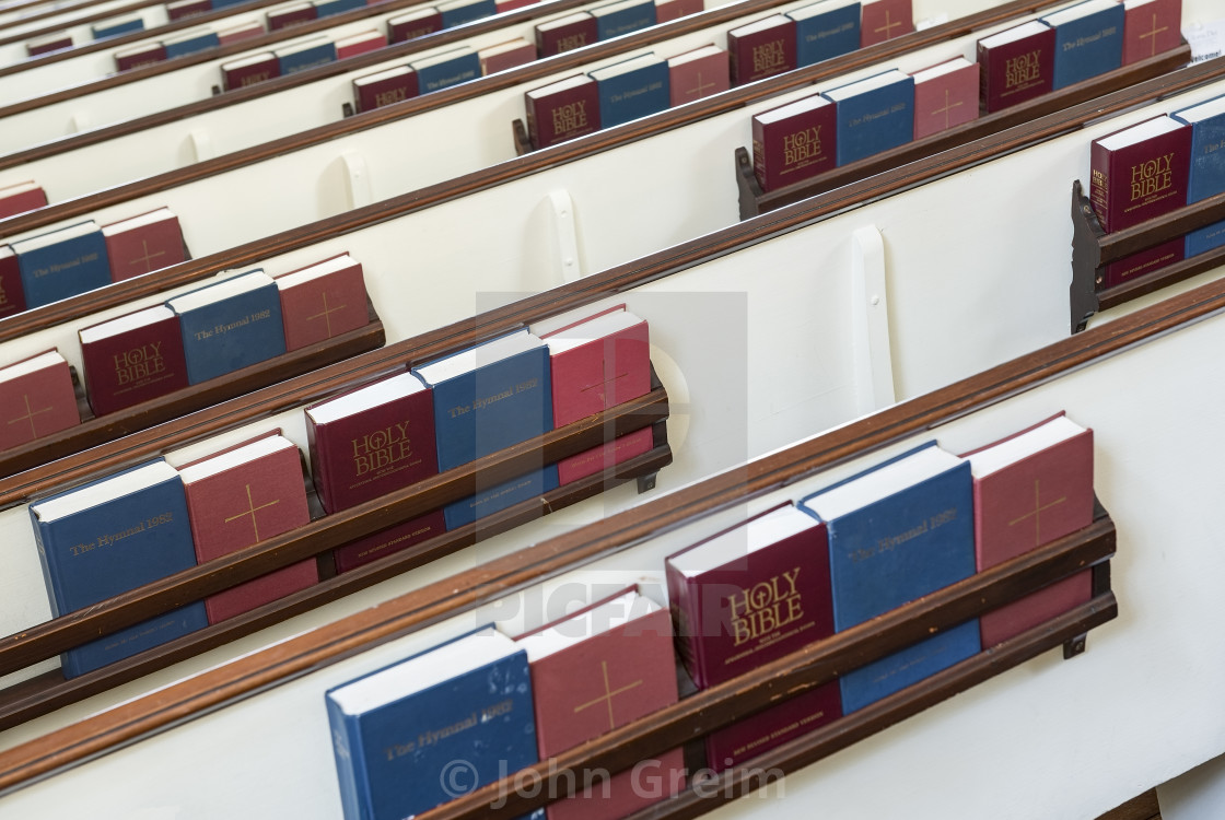 Church pews with prayerbooks and hymnals - License, download or