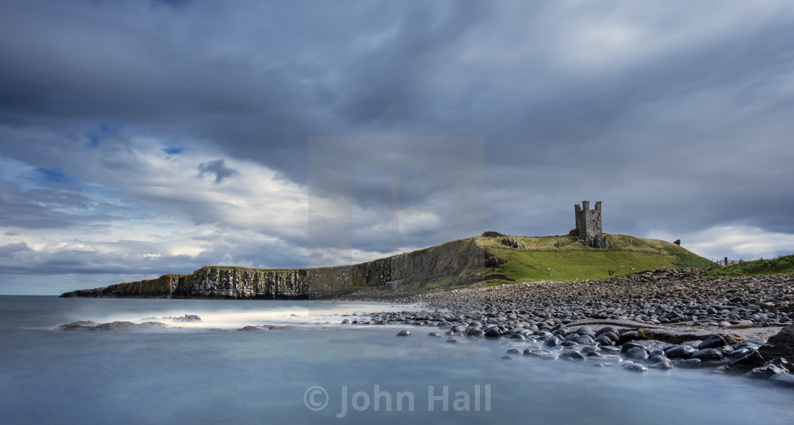 """Dunstanburgh Castle, Northumberland"" stock image"