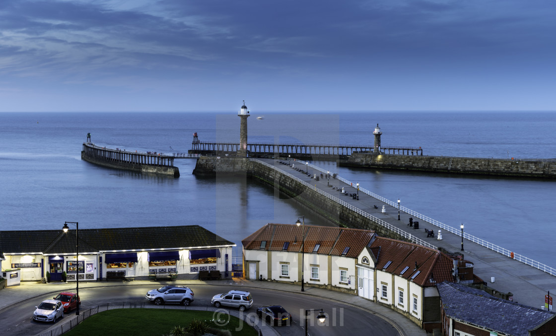 """Whitby Piers at Dusk"" stock image"