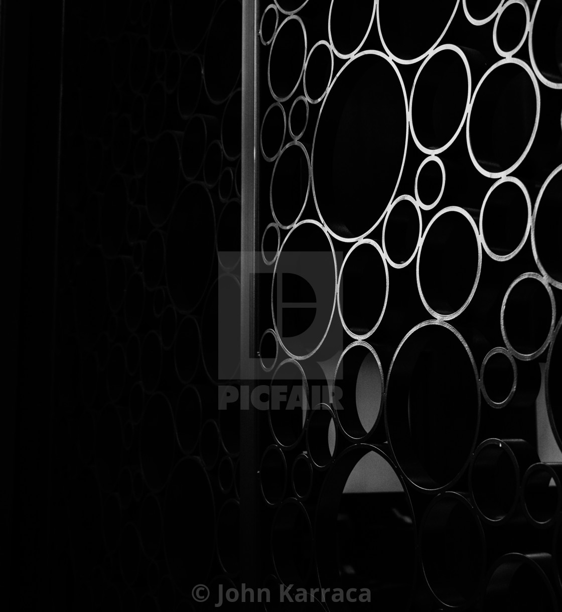 black steel circles on a gate create in an elegant background license download or print for 3 72 photos picfair https www picfair com pics 08394551 black steel circles on a gate create in an elegant background