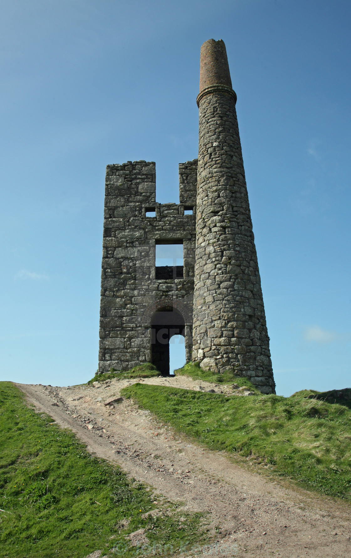 """The chimney of the engine pump house at Ding Dong Tin Mine Cornwall"" stock image"