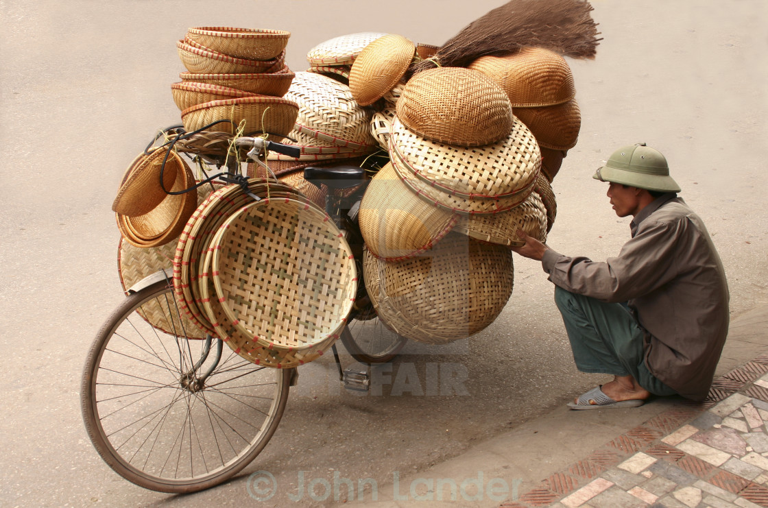 """Baskets Vendor, Hanoi Old Quarter"" stock image"