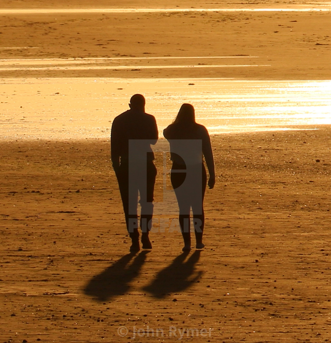 """""""Love is .... walking into the sunset."""" stock image"""