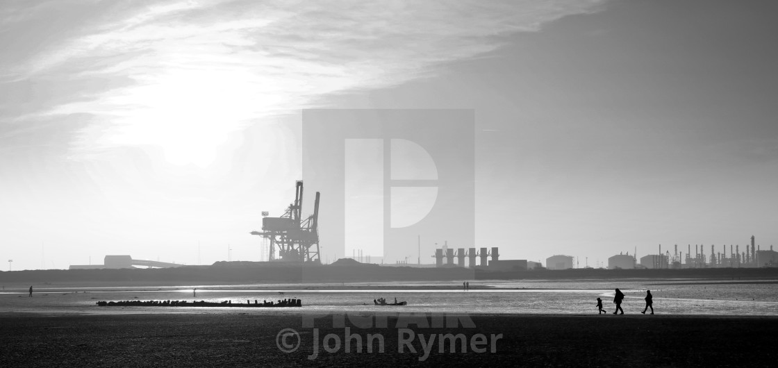 """""""A walk on the beach in the shadow of industrial Teesside."""" stock image"""