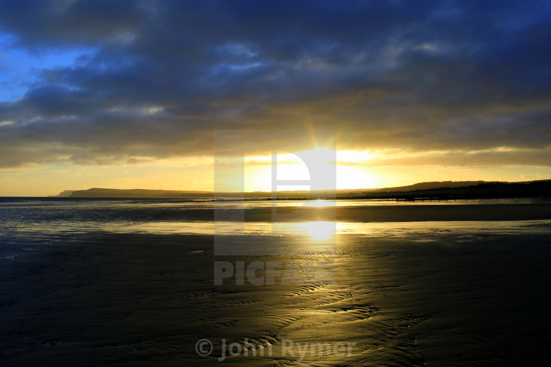 """Sunrise over Saltburn"" stock image"