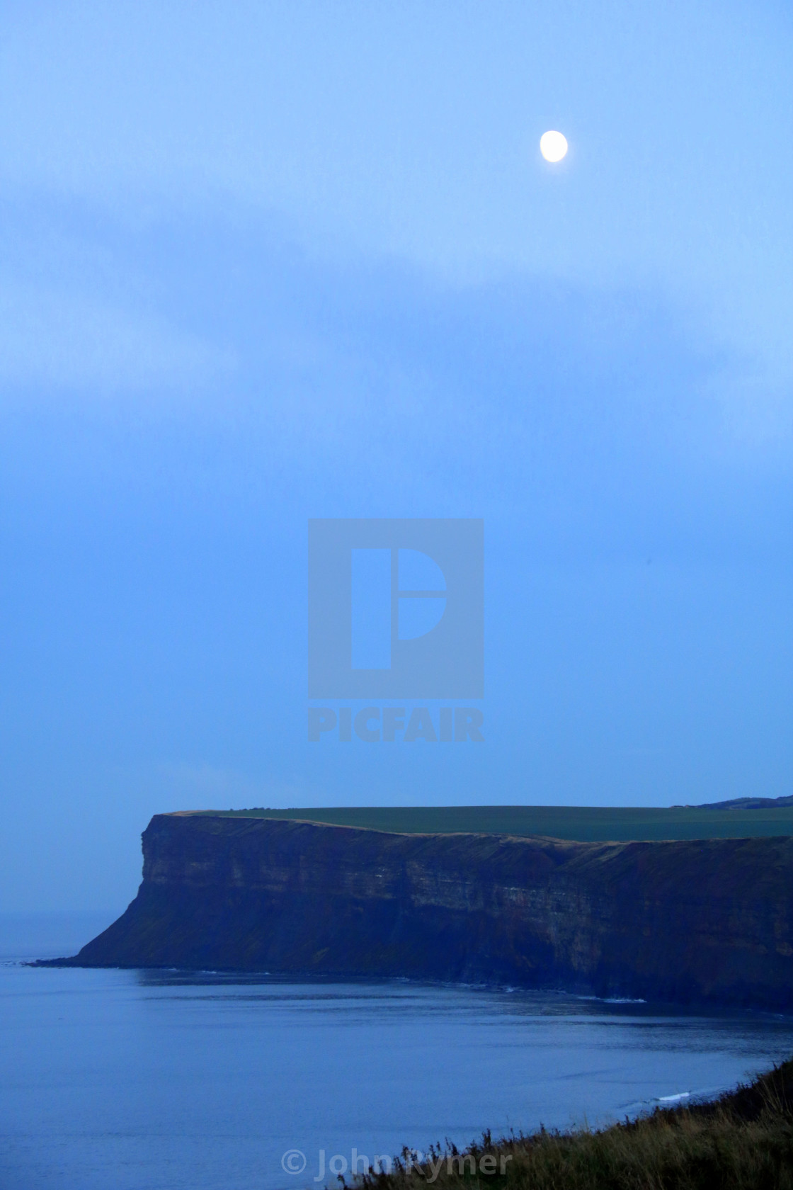 """""""The Moon over water. Saltburn by the Sea."""" stock image"""