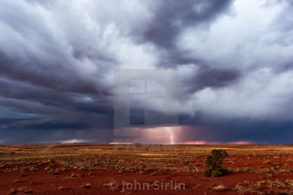 """Stormy sky with dramatic, dark clouds and lightning."" stock image"