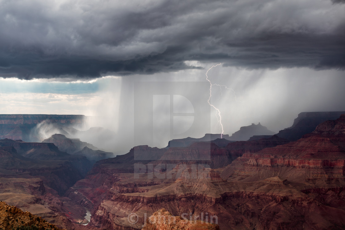 """Lightning strikes as a thunderstorm moves through the Grand Canyon"" stock image"