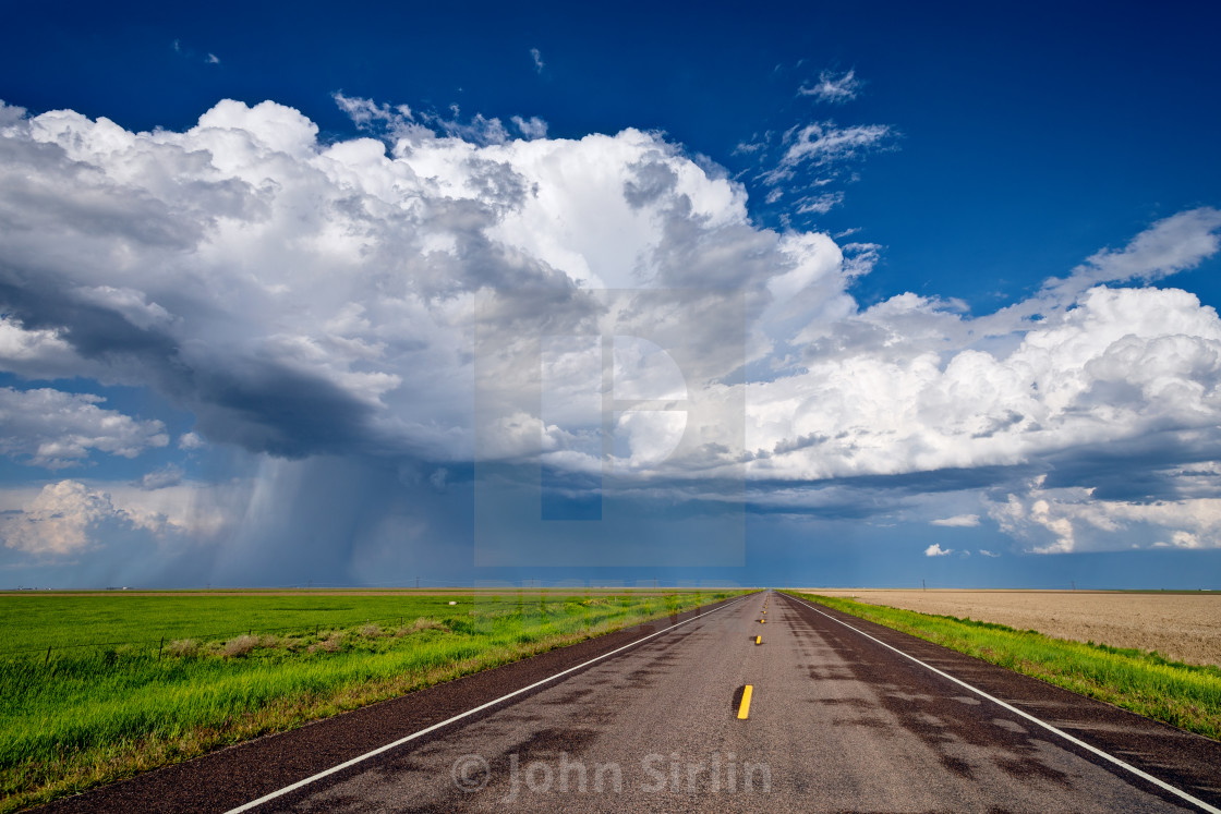 """""""Long straight road leading to a storm on the horizon"""" stock image"""